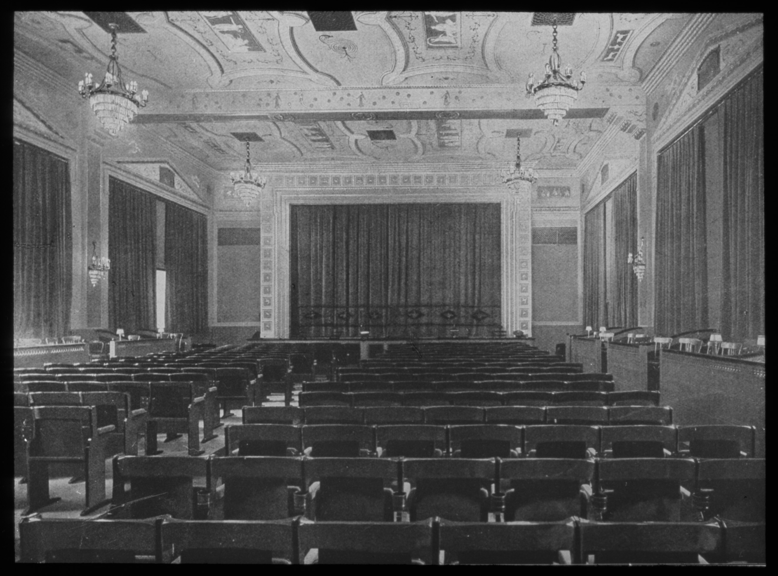 Black and white photo of the auditorium facing the screen.