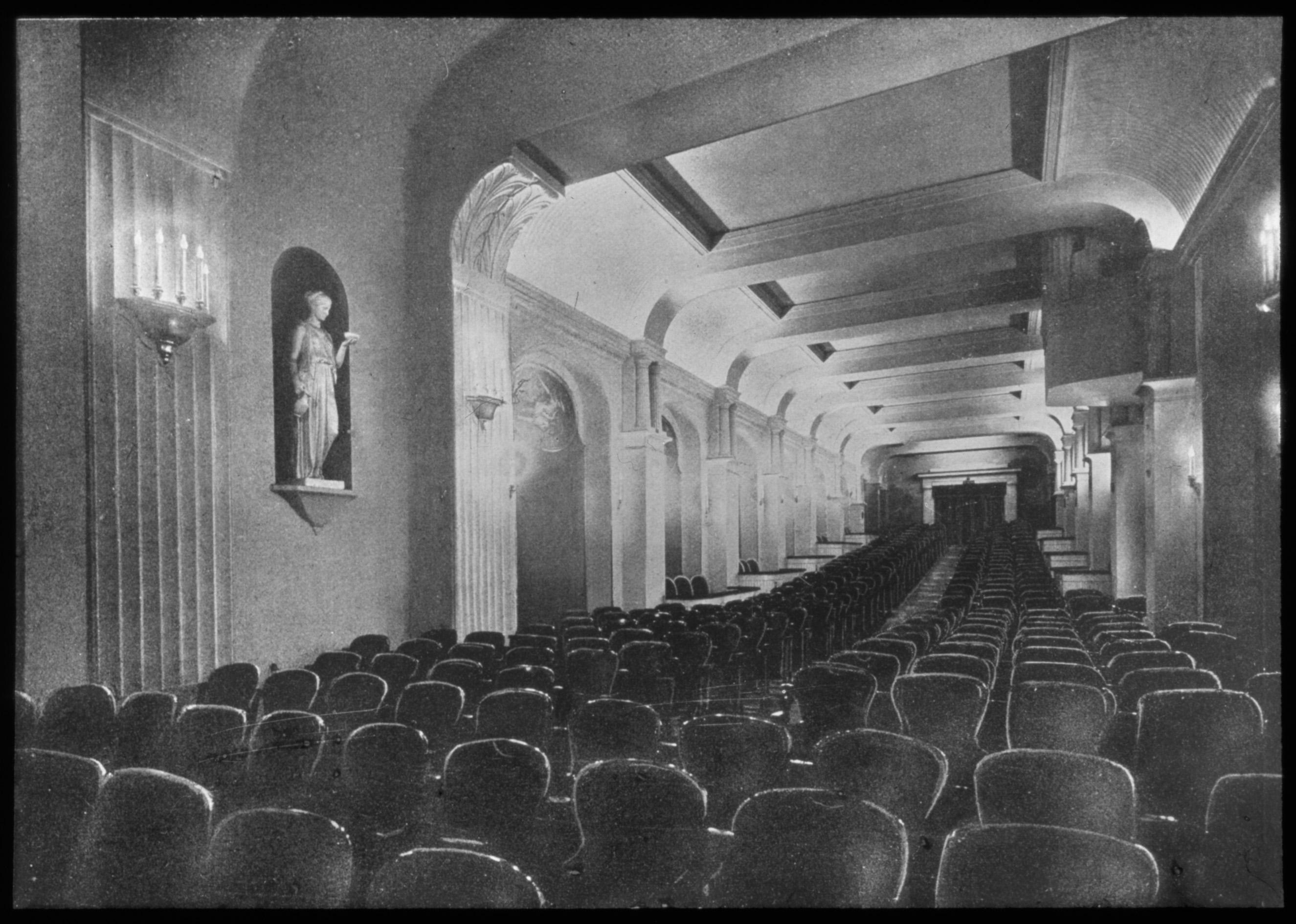 Black and white photo: auditorium facing the back.