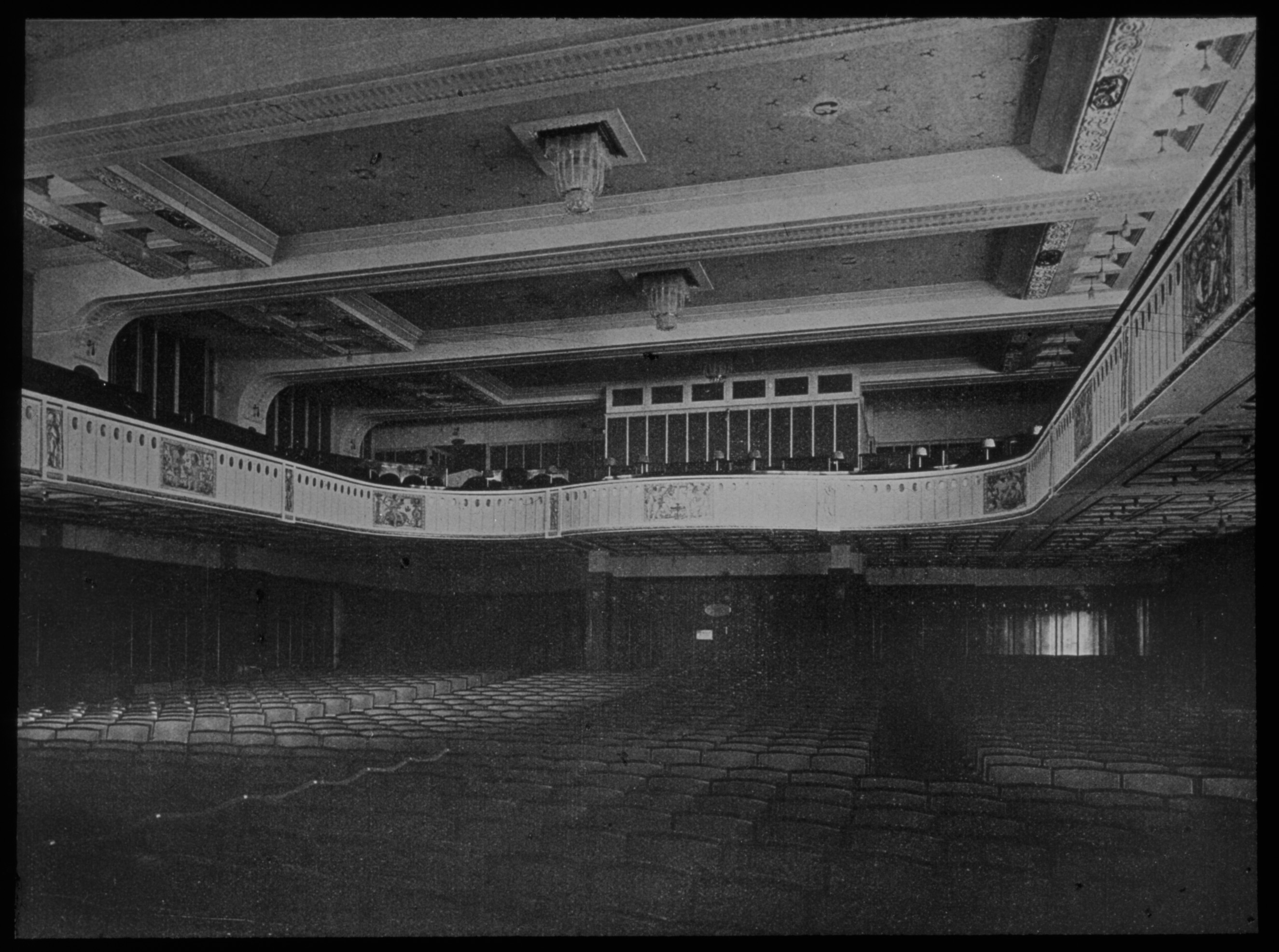 Black and white photo of the auditorium facing the back.
