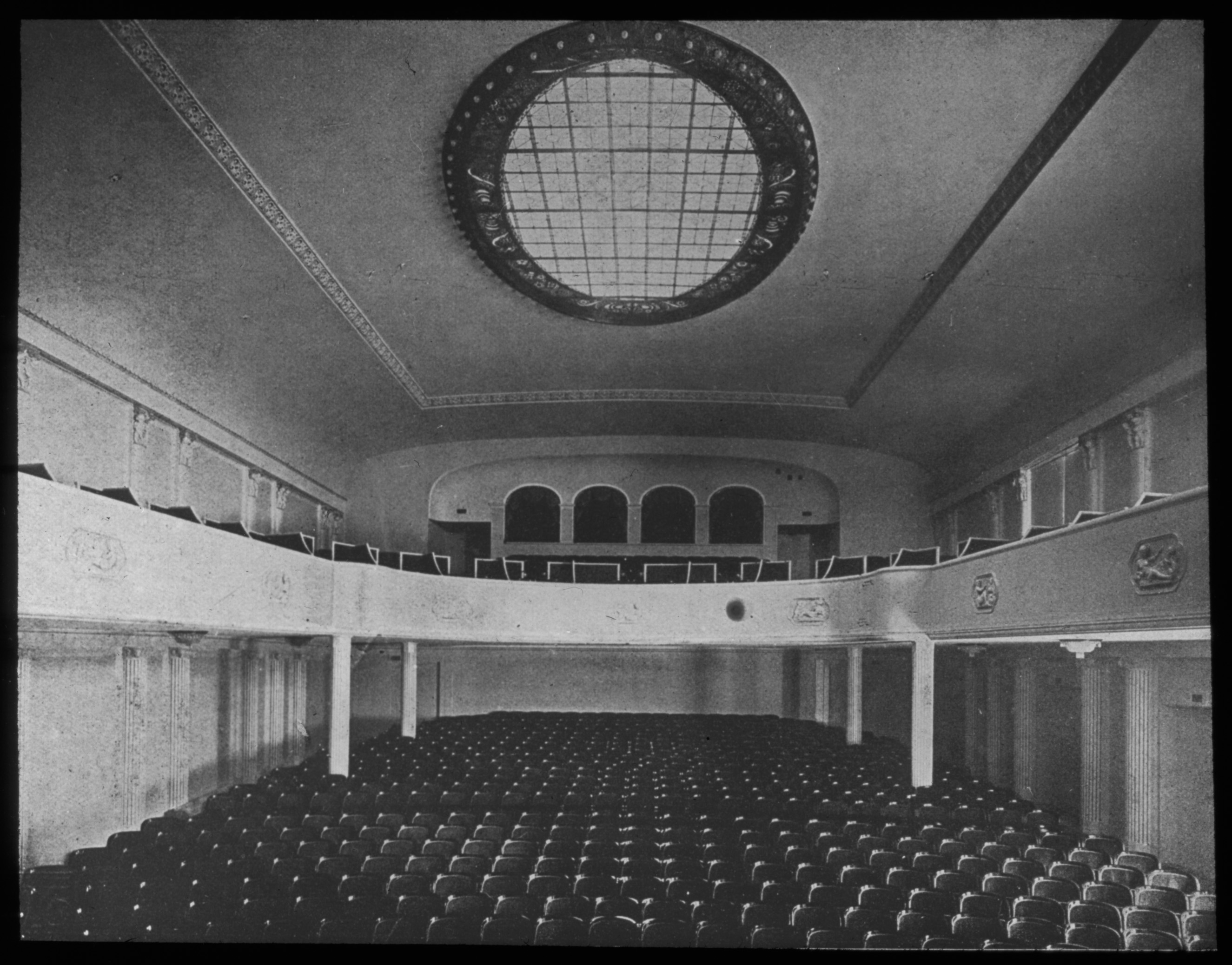 Black and white photo of the auditorium facing back