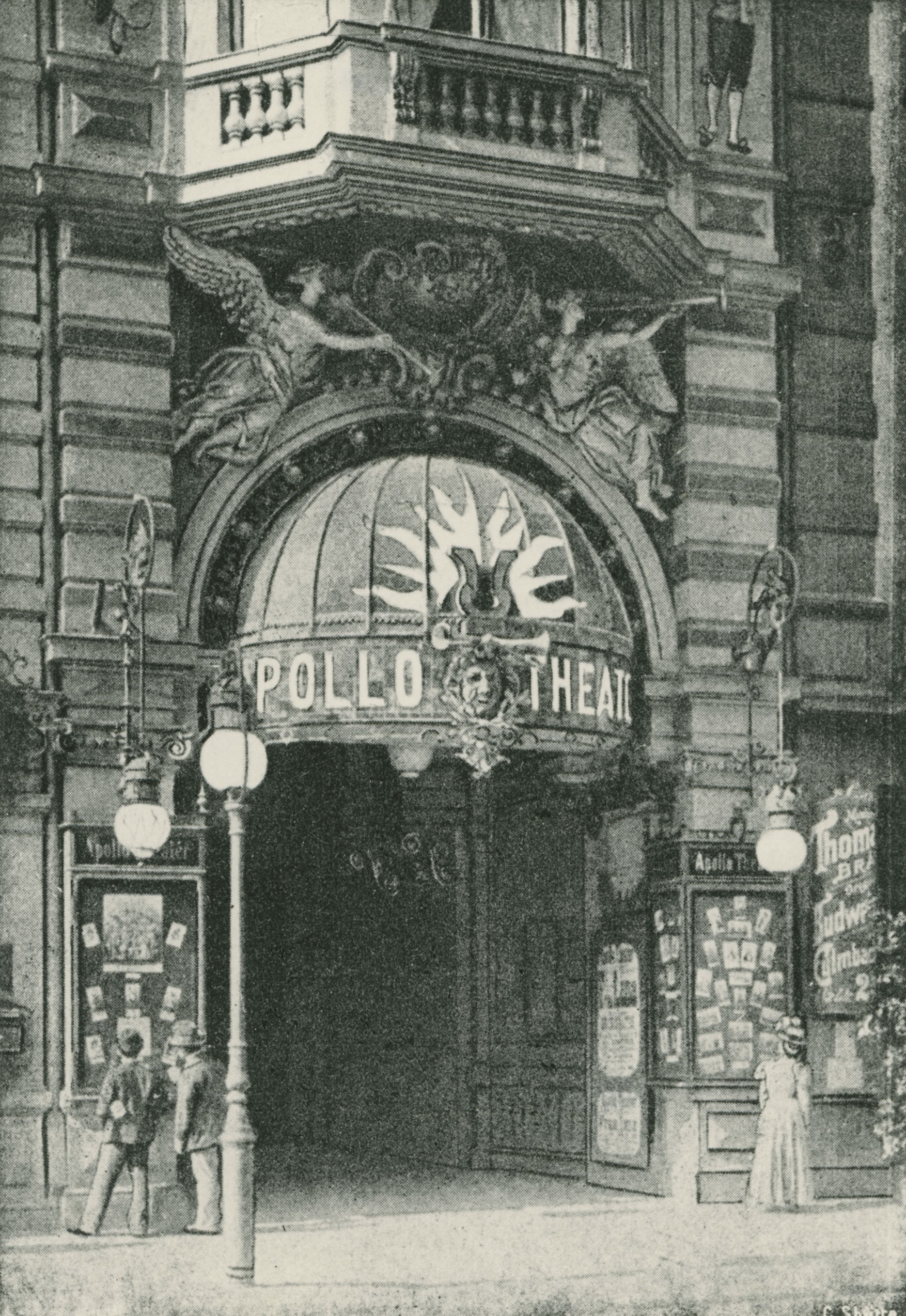 Black and white photo of a dome and sculptures of angels above the entrance of the cinema.