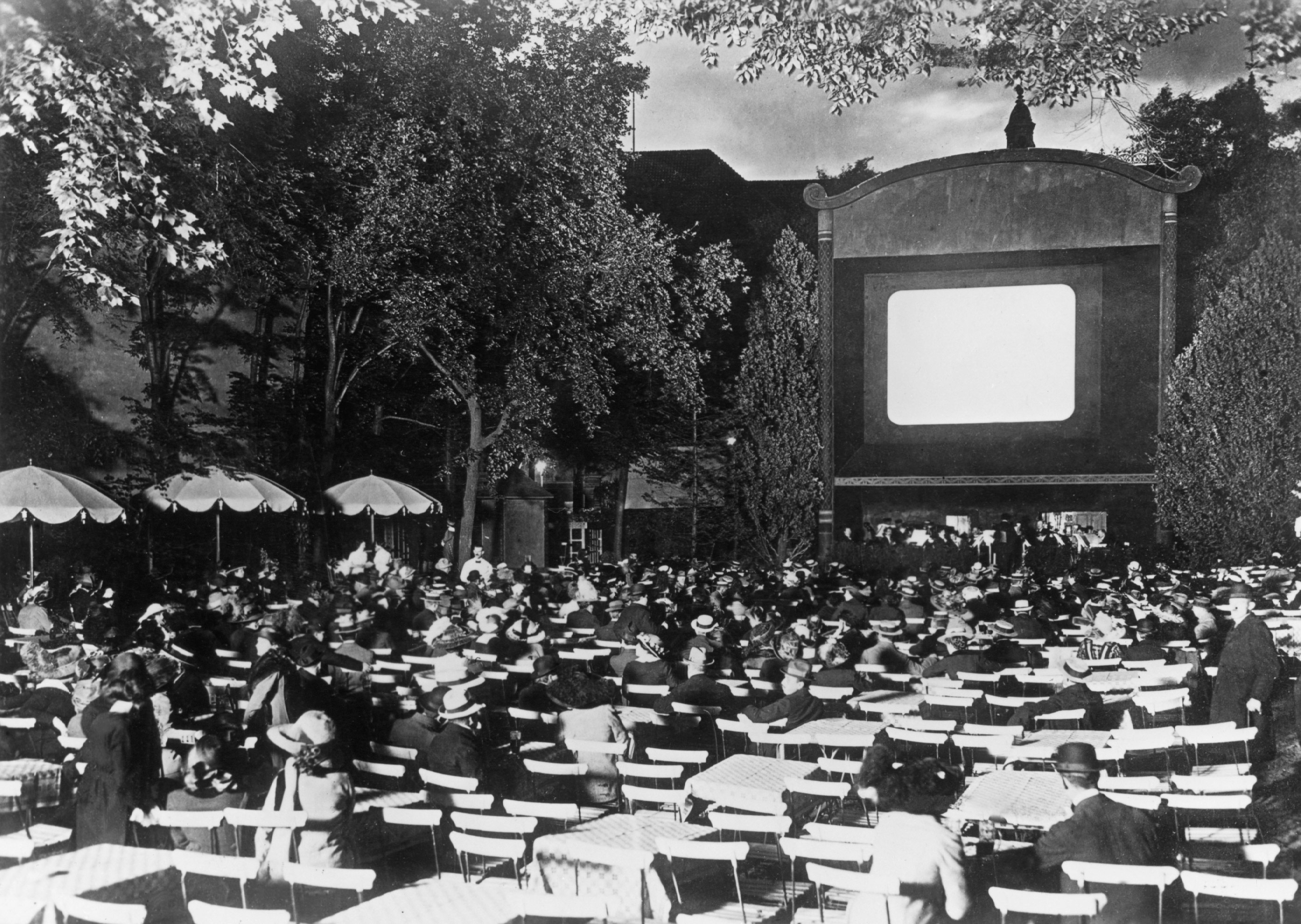Black and white photo: view of the screen with guests