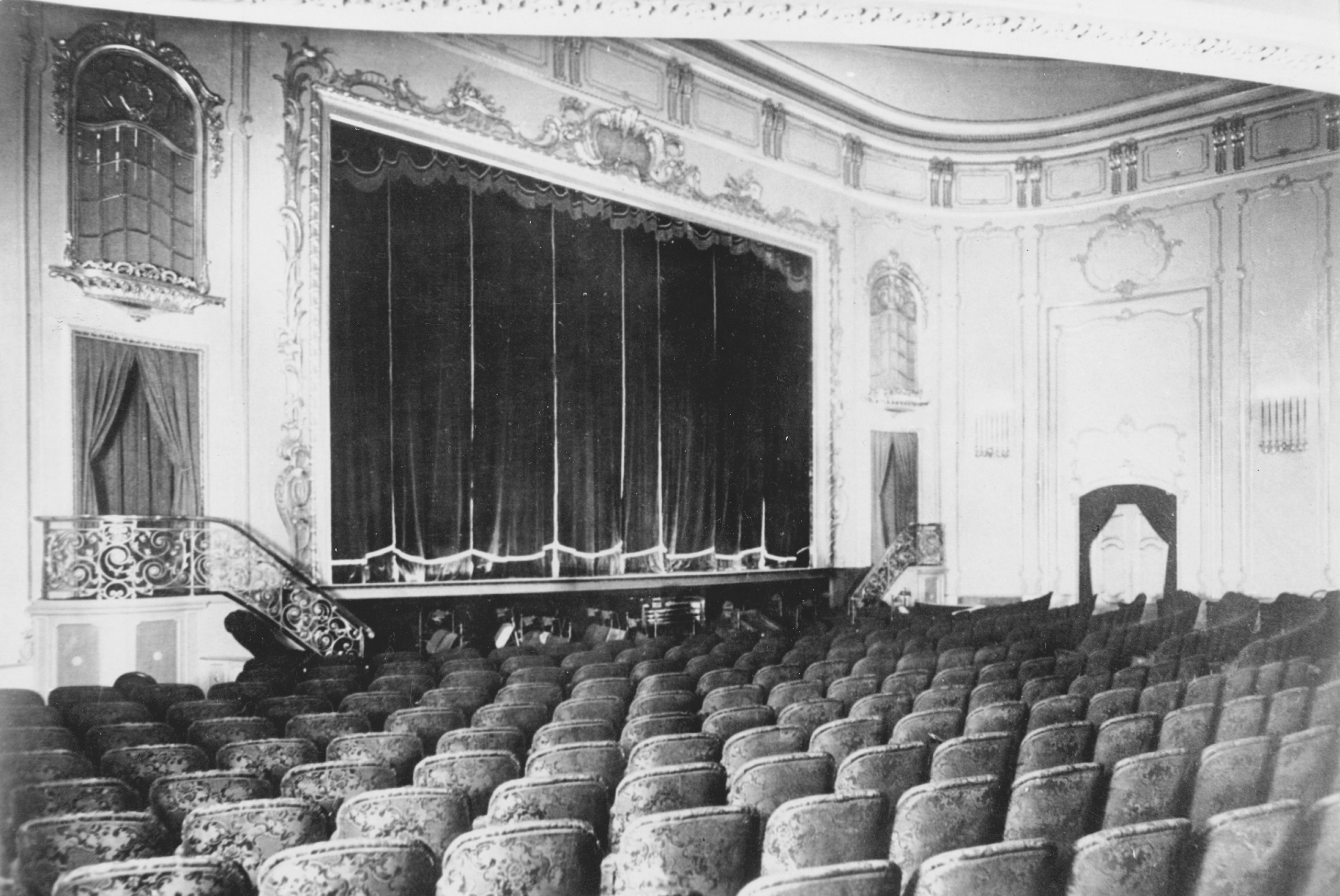 Black and white photo of the auditorium facing the screen