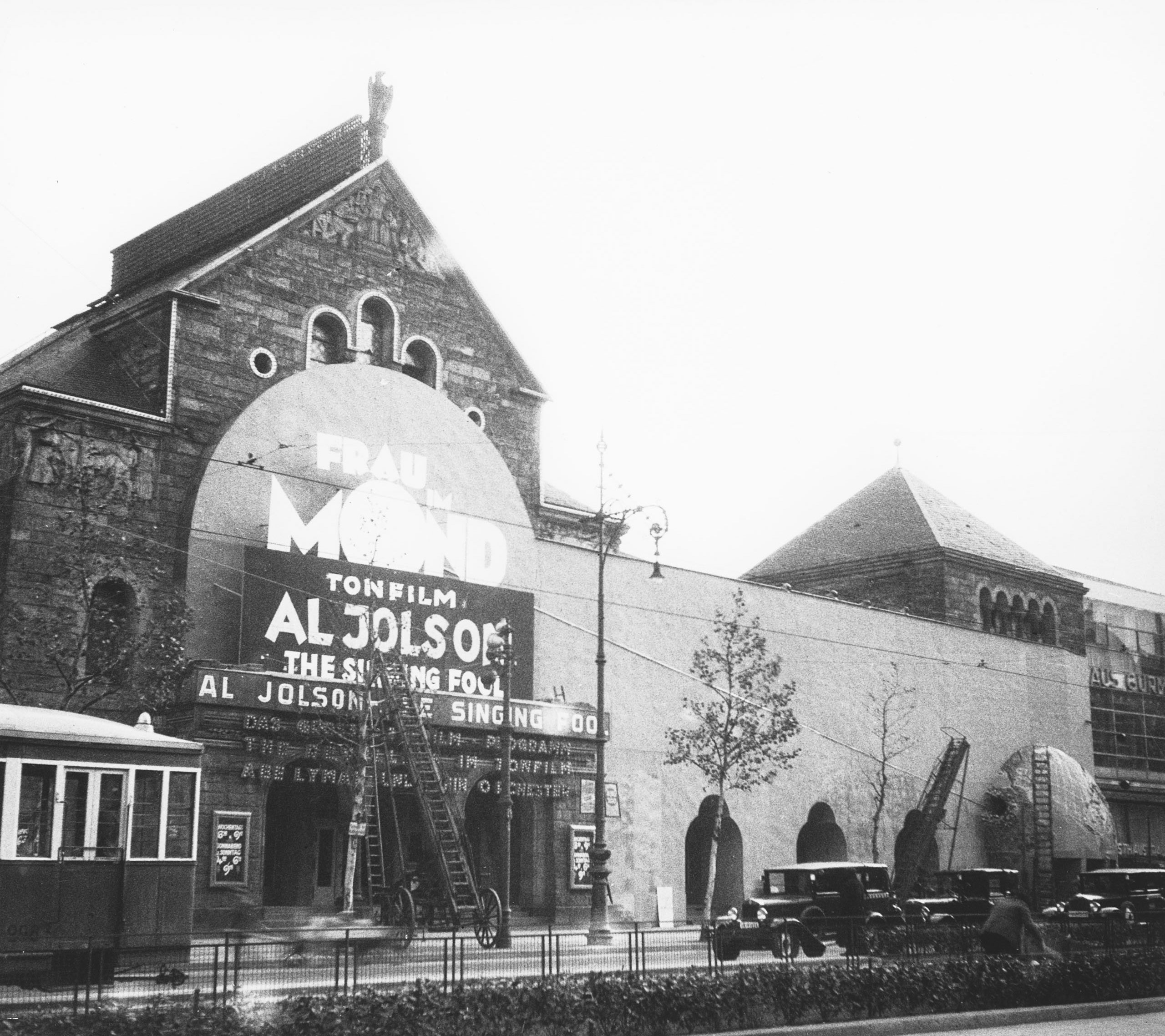 Black and white photo of the façade with advertisments in the shape of the moon