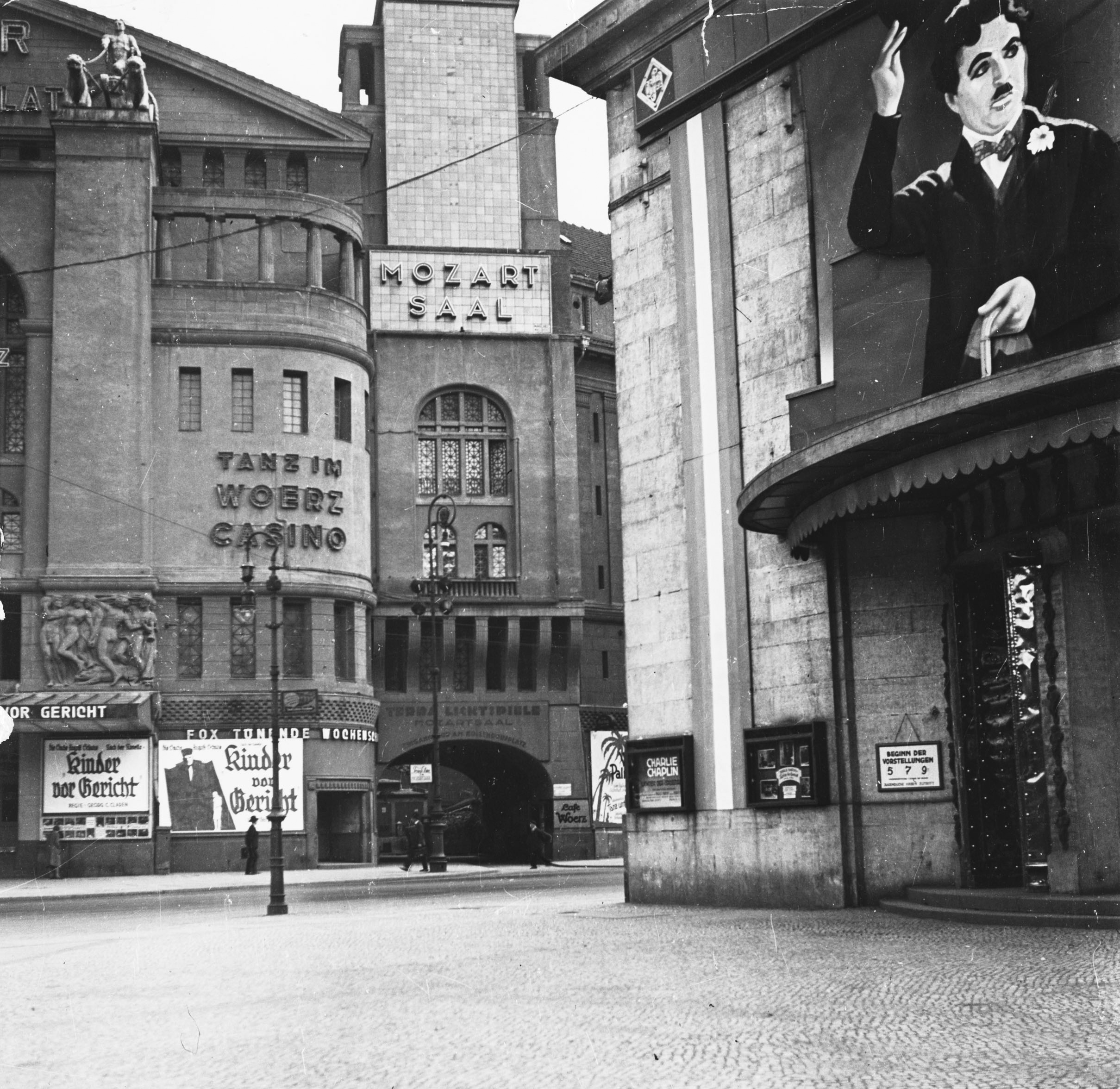 Black and white photo of the façade and an illustration of Charlie Chaplin