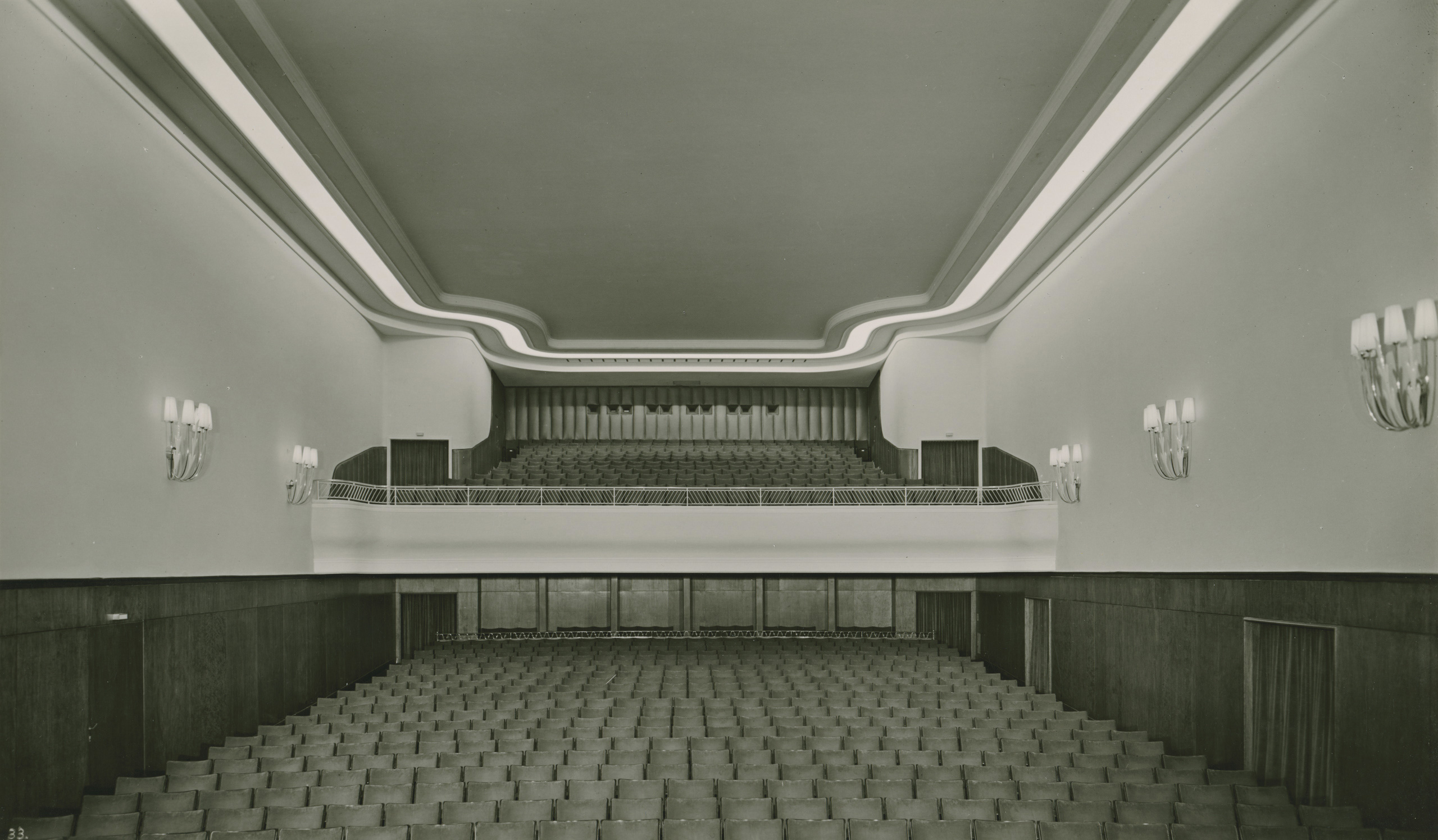Black and white photo: the auditorium facing back