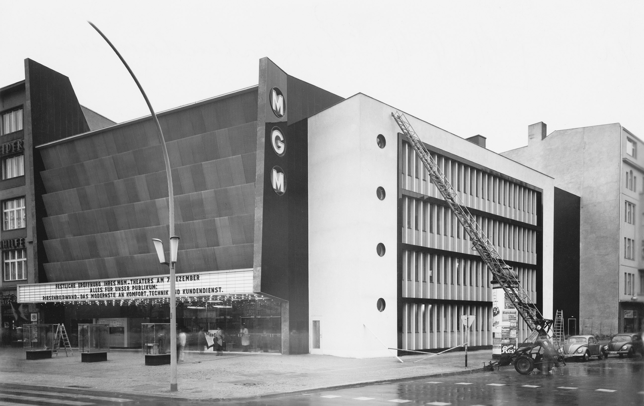 Black and white photo: cinema façade display panel