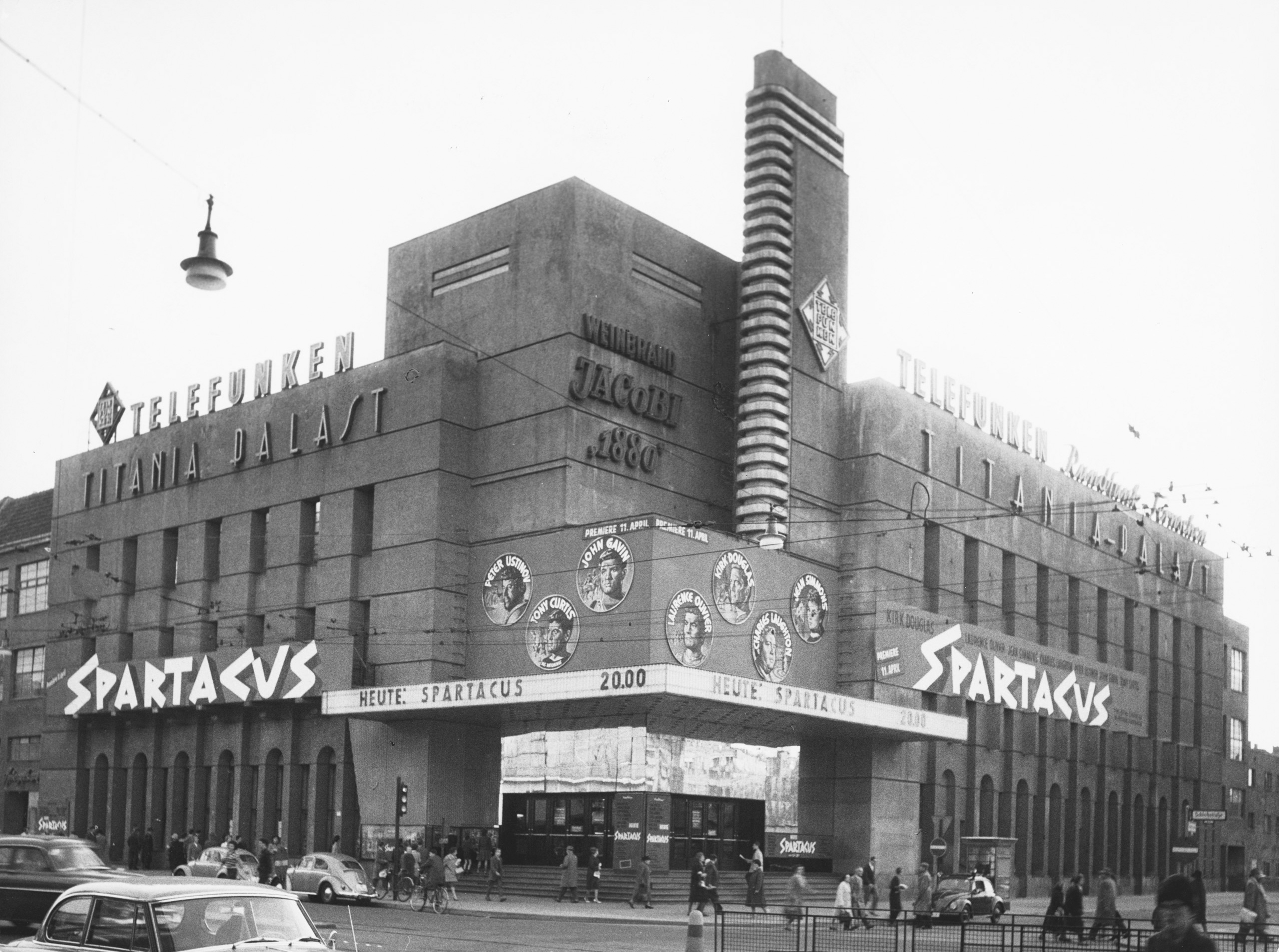 Black and white photo of the cinema with film advertisements