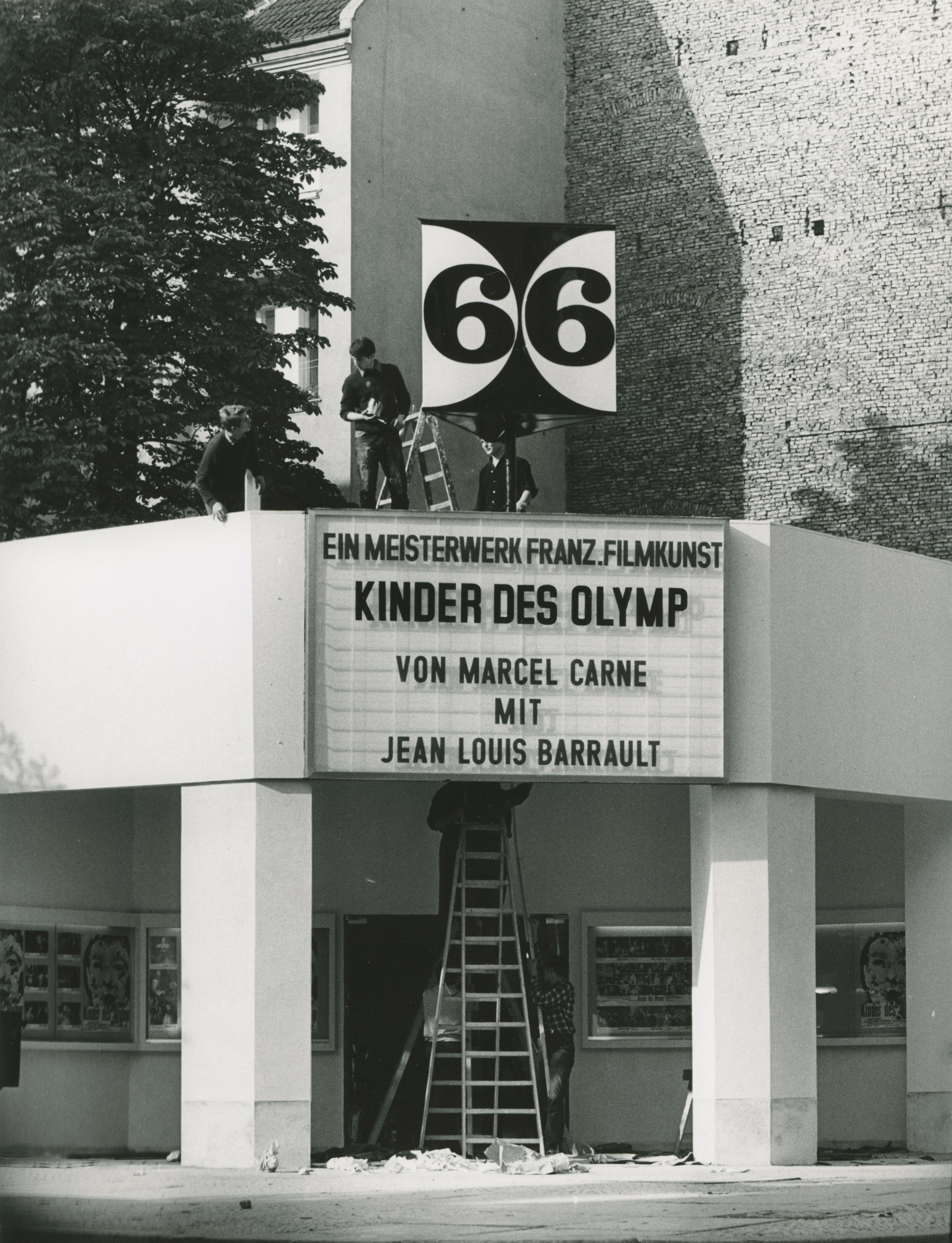 Black and white photo: façade with display panel
