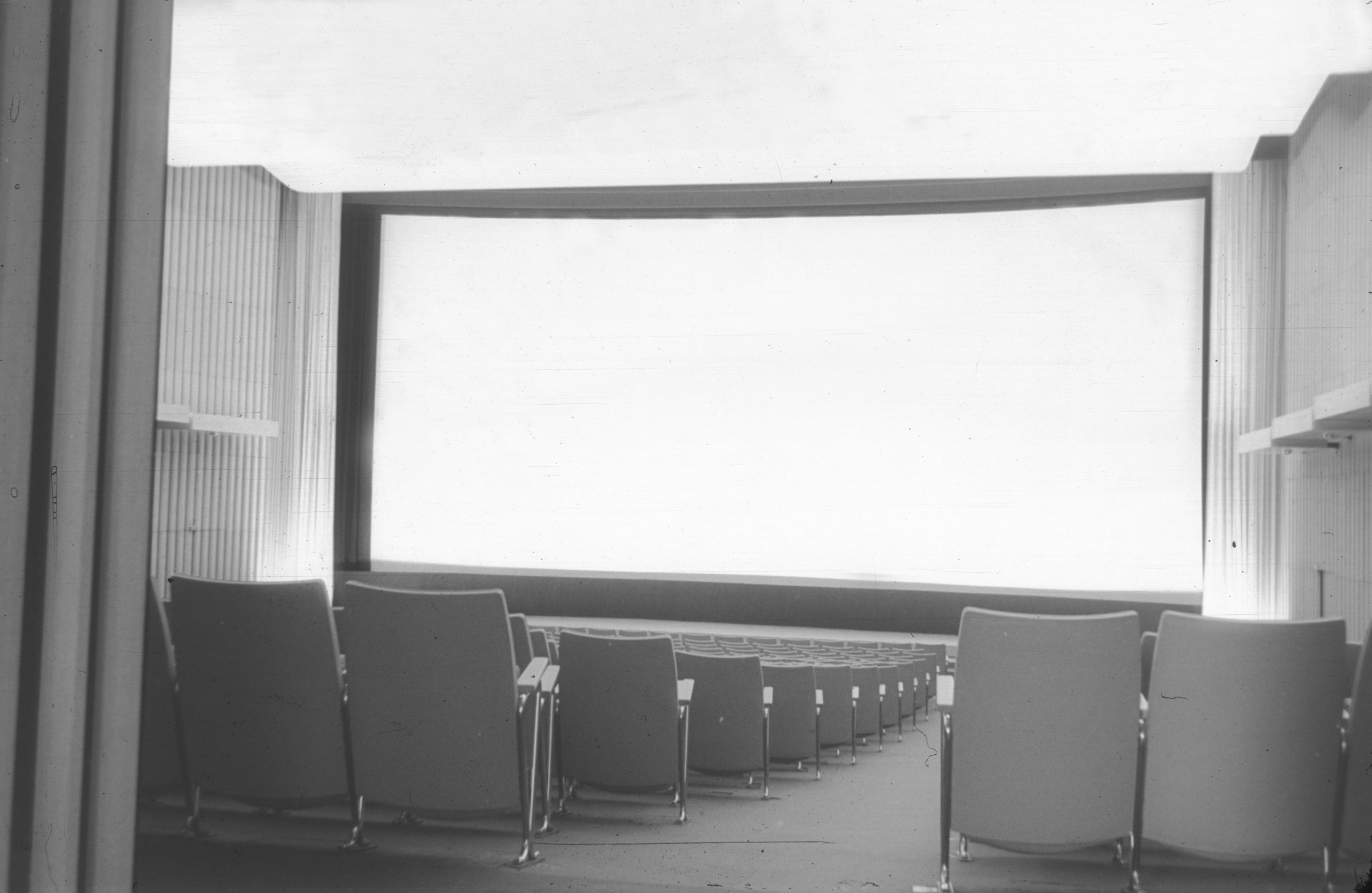 Black and white photo of the auditorium and the screen