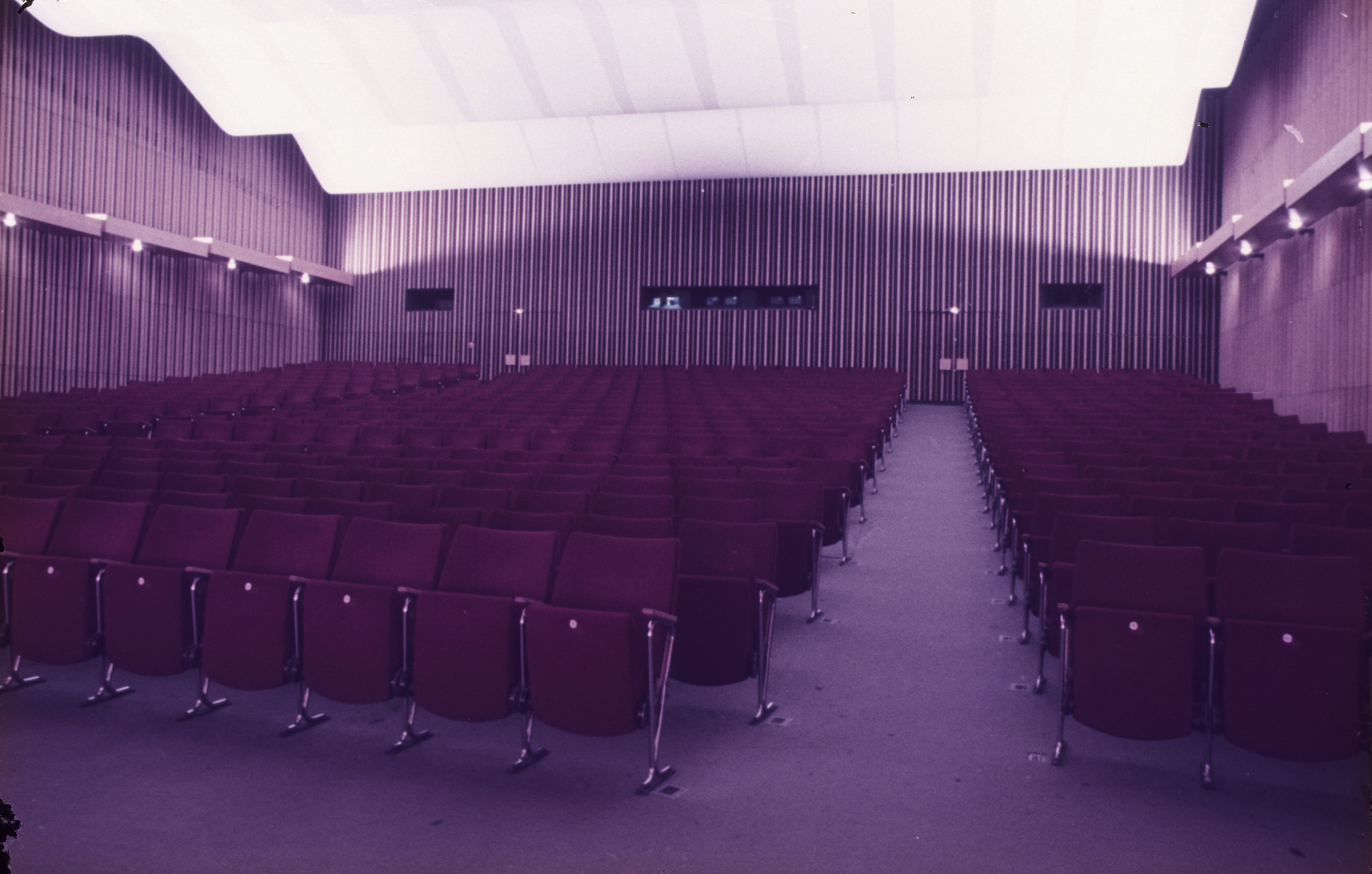 Color photo: auditorium facing the back