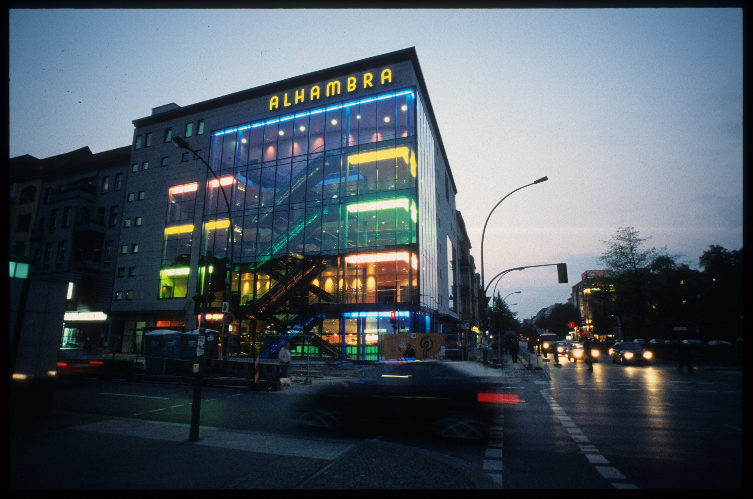 Color photo: cinema with glas front and and neon tubes