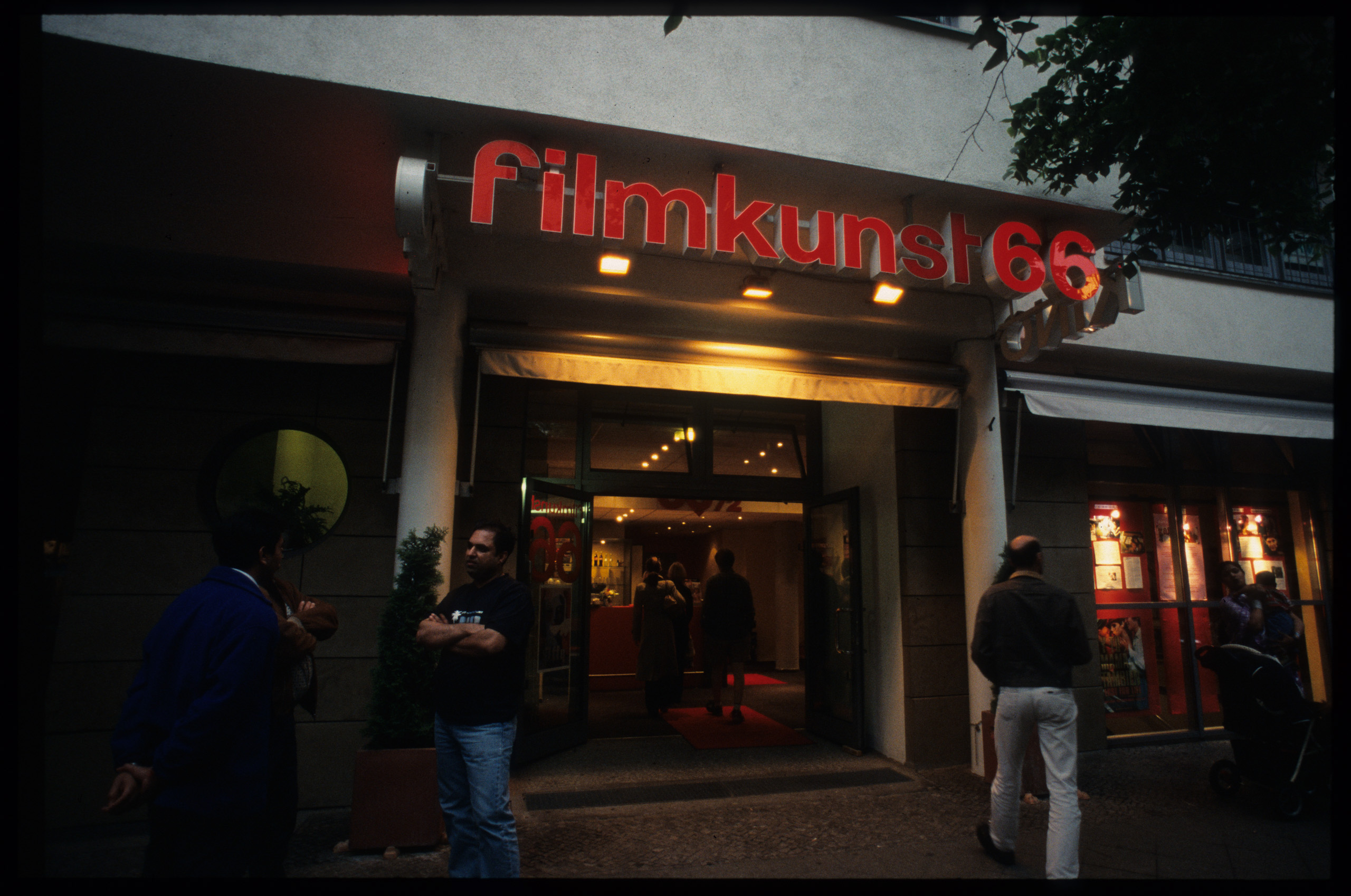 Color photo: entrance of the cinema with visitors