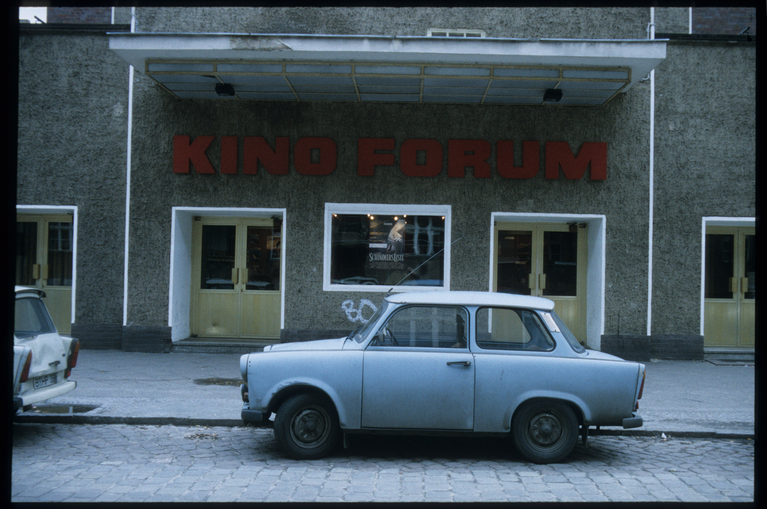 Color photo: cinema entrance with lettering