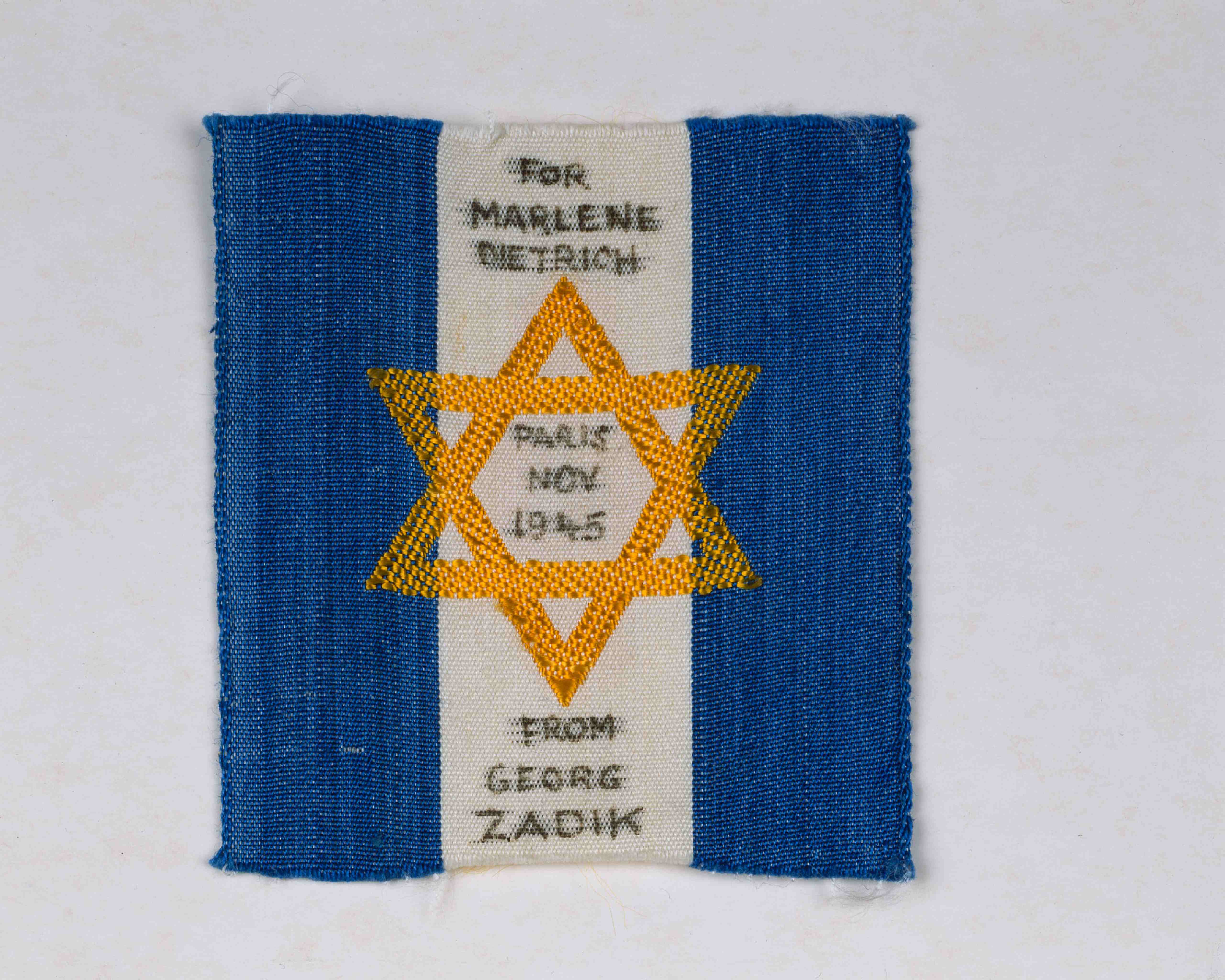 "Fan gift to Marlene Dietrich: Badge with a Star of David and the dedication ""For Marlene Dietrich – Paris Nov. 1945 – from Georg Zadik"""