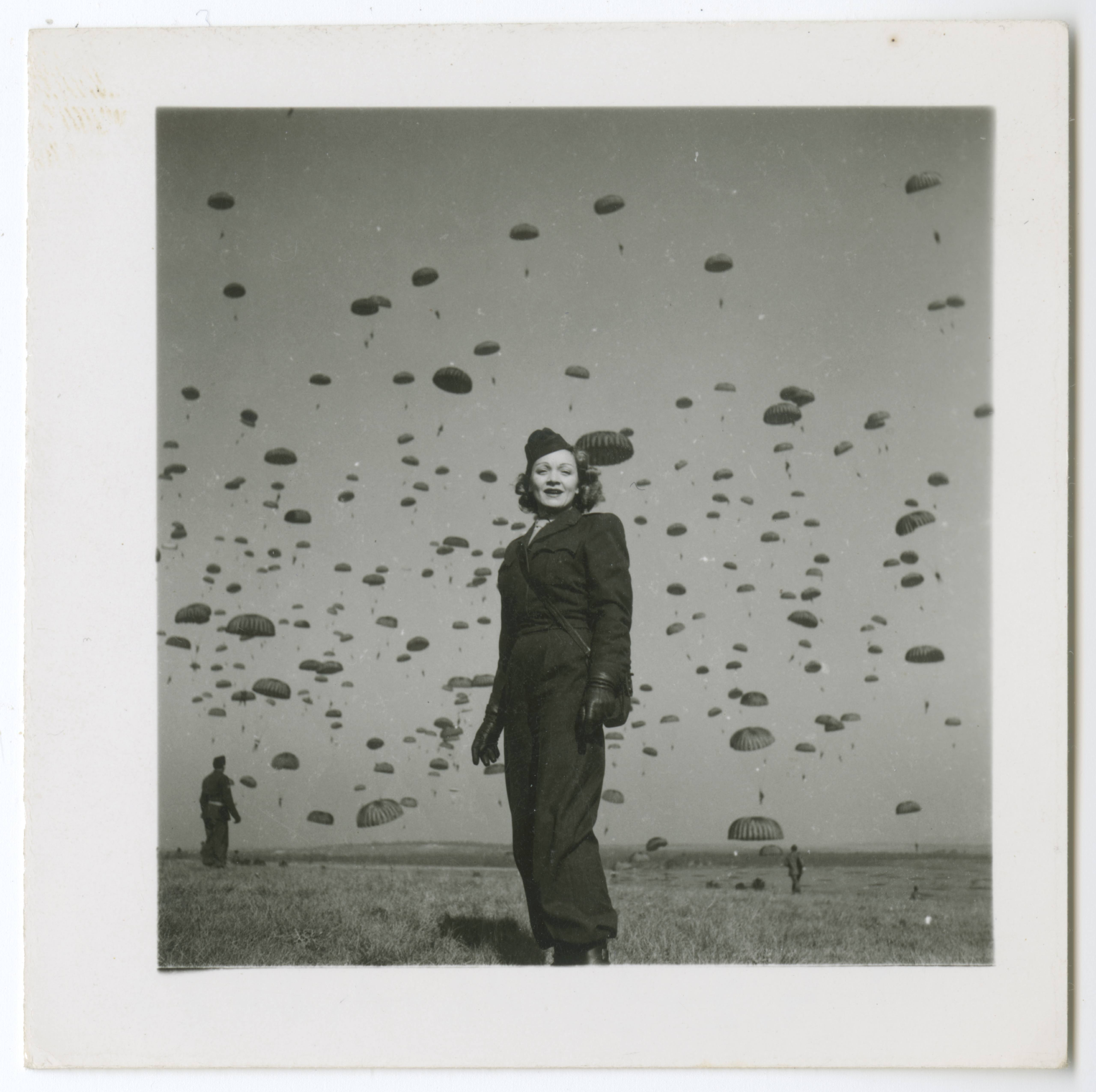 Marlene Dietrich on a paratrooper practice jump with the 82nd Airborne Division, Soissons in northern France, 13 March 1945