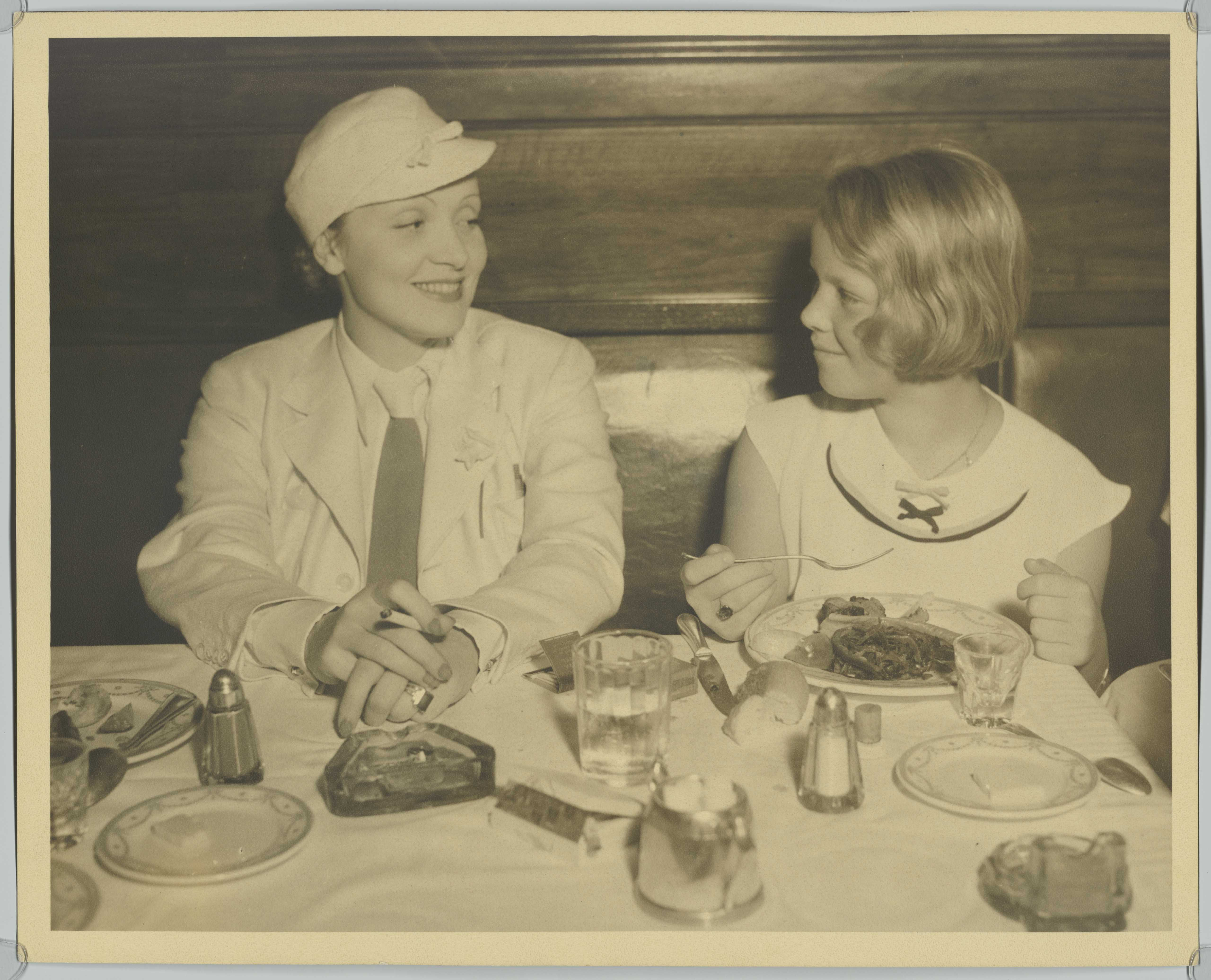 Marlene Dietrich visits a restaurant with daughter Maria, Los Angeles, March 1934