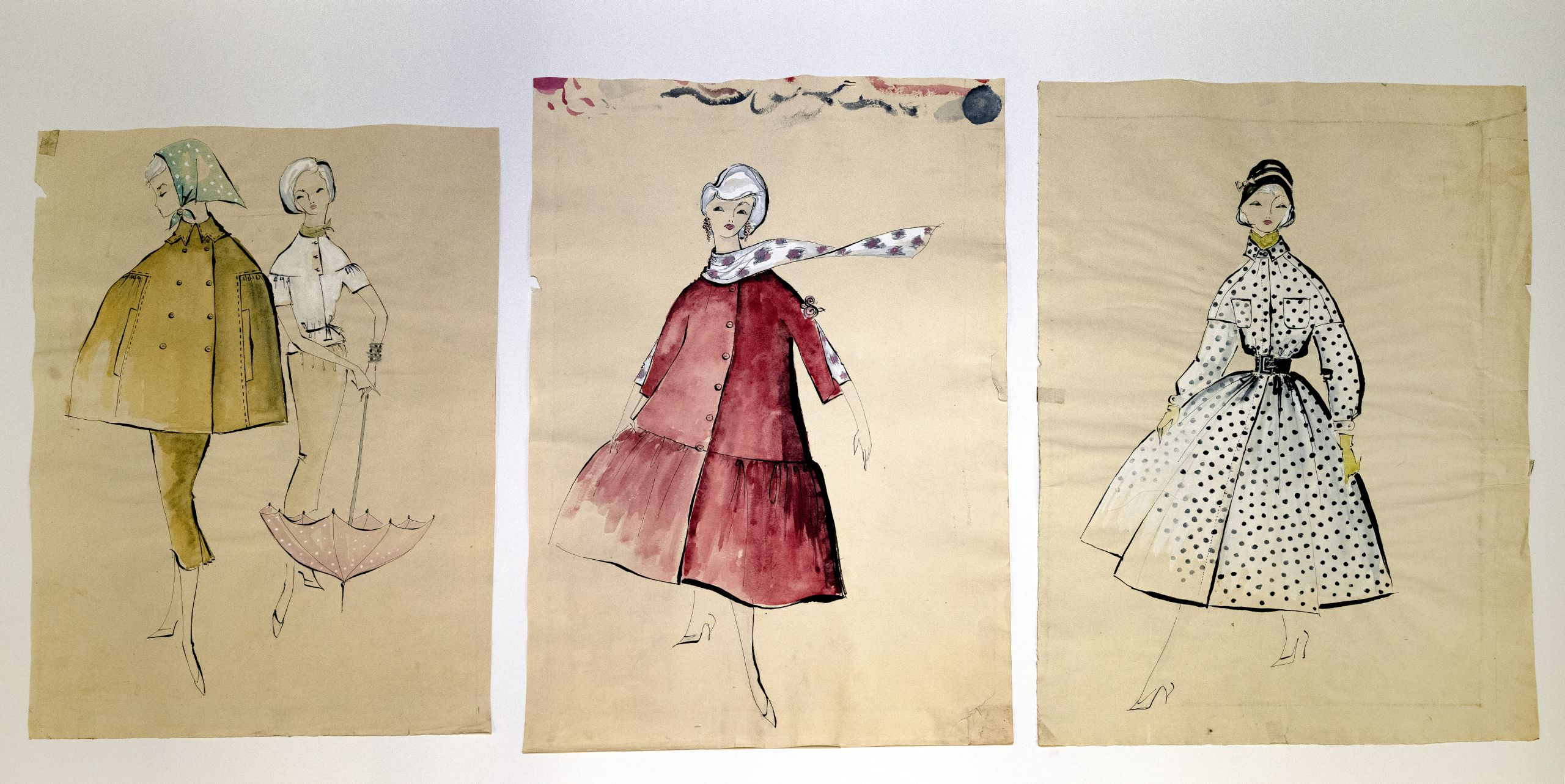 Drawings of three dresses in color