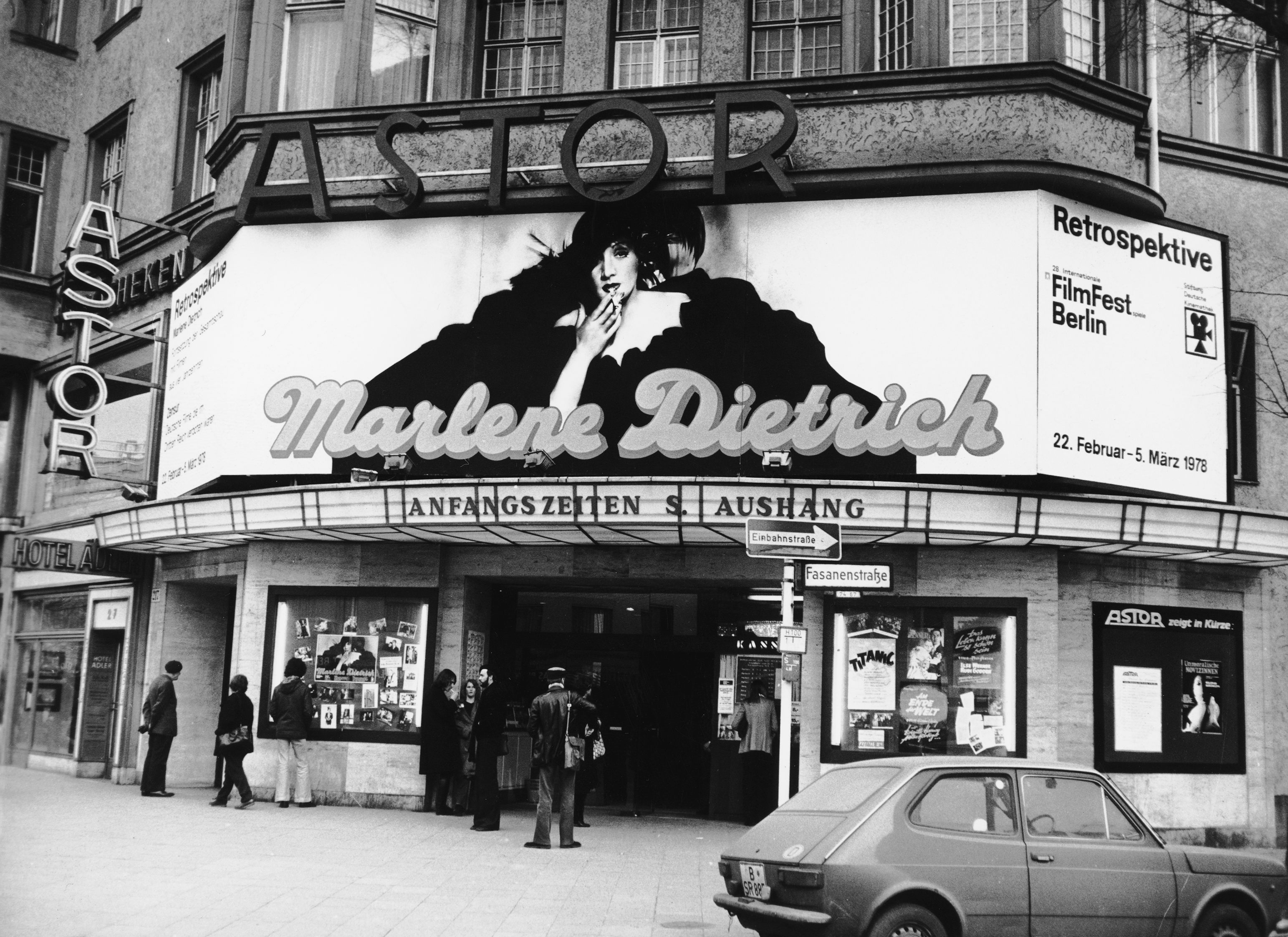 Black and white photo: entrance to the cinema with a big poster of Marlene Dietrich during the Berlinale Retrospective in 1978