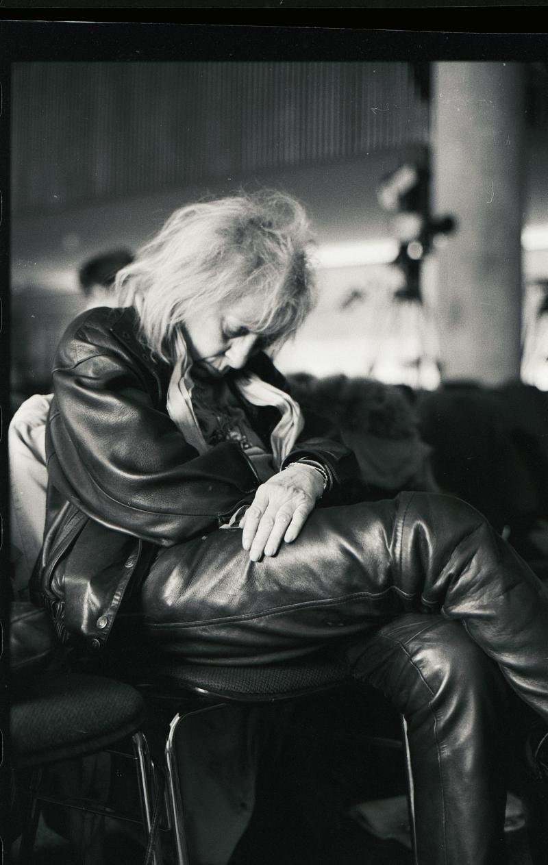 The photographer Erika Rabau sleeping in a cinema foyer