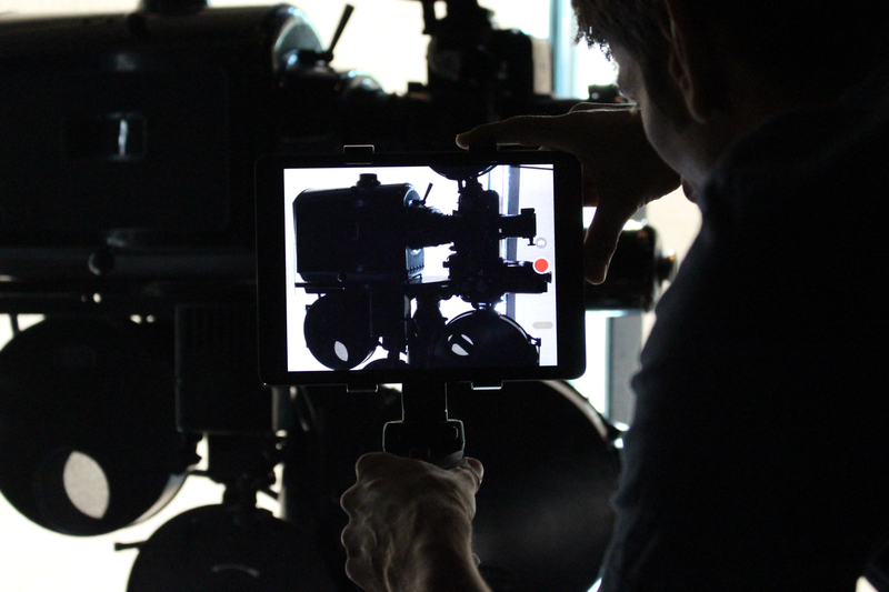 A man working with a film camera