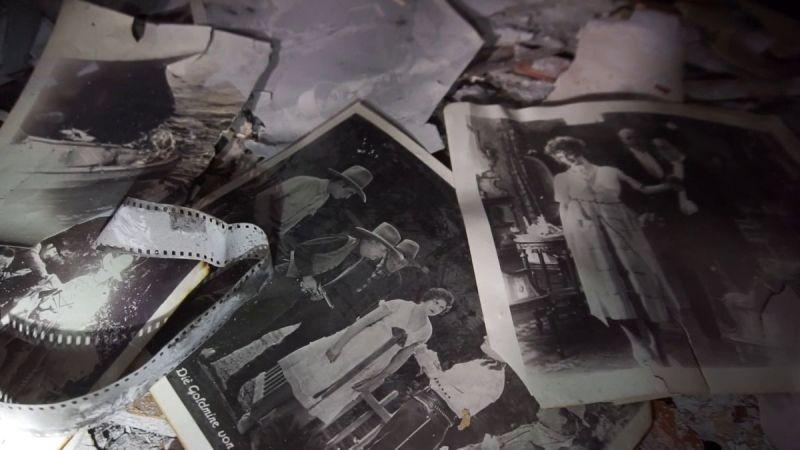 Damaged photographs, film rolls and graphics.
