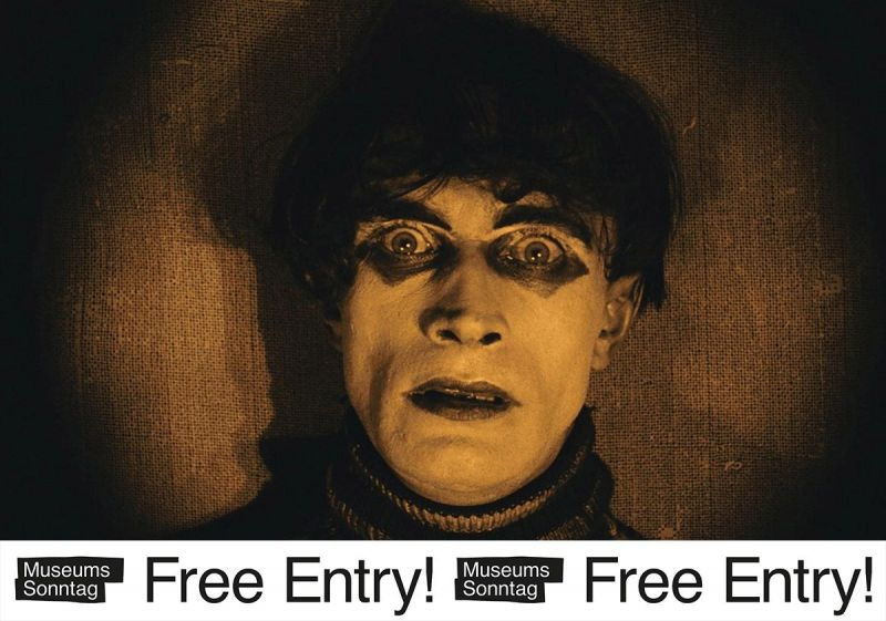 """Close-up of Conrad Veidt as Cesare in Das Cabinet des Dr. Caligari with the banner """"Museumssonntag –  Free Entry!"""