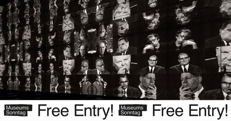 """Screenwall showing many differenc faces with the sticker """"Museum Sunday – Free Entry!"""""""