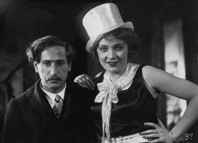 Josef von Sternberg and Marlene Dietrich standing next to each other posing for the photo.
