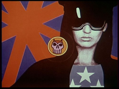 Still from Idea: collage of a woman in black-and-white, star-spangled shirt and sunglasses, scull emblem and red-and-blue background