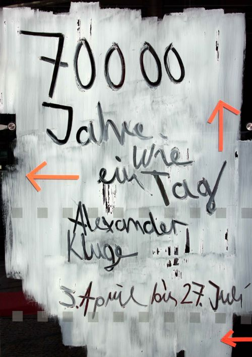 "Photo of the exhibition title ""70,000 Years Just Like One Day — Alexander Kluge's Current Work for Television Films, Plus an Installation – A Place of Enchantment"", Deutsche Kinemathek, Berlin"
