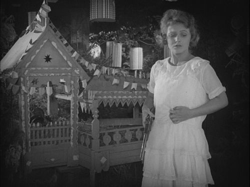 Black and white still from the film The House of Lies