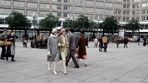 Still from Babylon Berlin: Two women walking across Alexanderplatz.